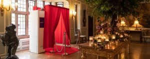 photo booth with red carpet at wedding reception